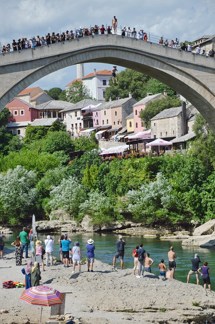 Mostar Diving Club member jumping into the river