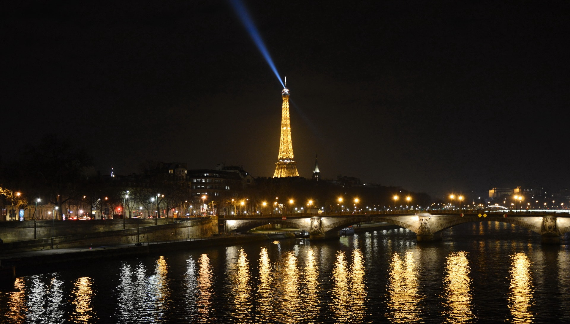 The Eiffel Tower at midnight seen from Pont Alexandre III