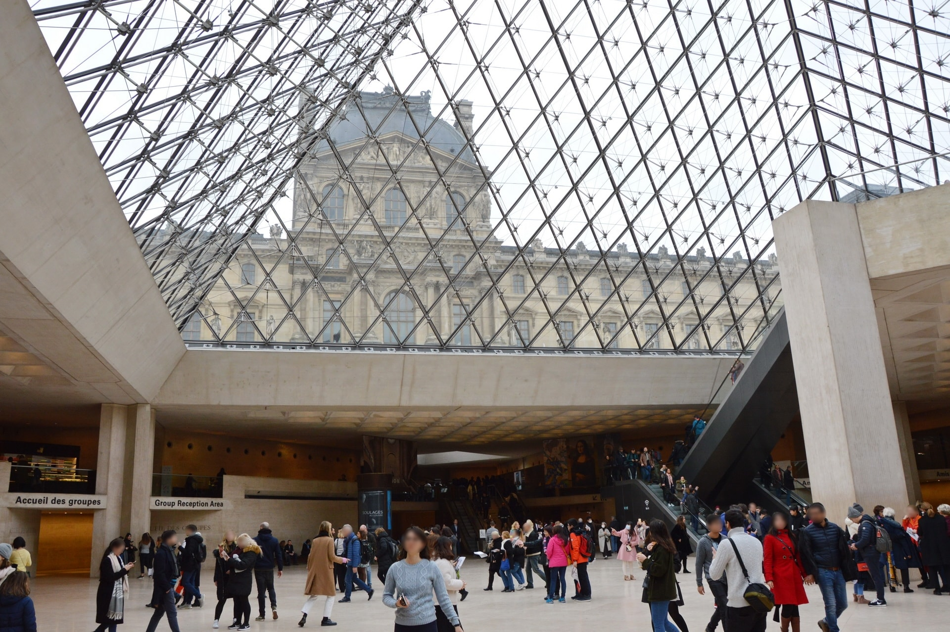 Under the unique Louvre Pyramid
